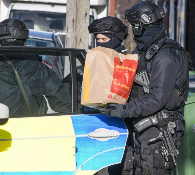 **Moving Footage with relevant desk** Pic by SnapperSK - (Pictured: Armed police have surrounded a house in Park Court off Park Street in Kidderminster after a man threatened to blow up the property. Police were seen arriving with McDonalds to encourage the man to leave the property as negotiators shouted up to the first floor window during the siege. Hereford and Worcester fire service were on standby with a hose leading up to the property. A National Incident Liason Officer (NILO) was also present at the incident. Pic taken 28/01/2020) -