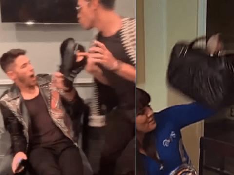 Nick and Joe Jonas recreate Kim and Khloe Kardashian's epic handbag fight and it's perfect