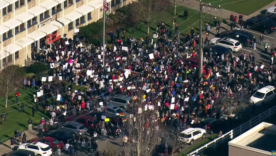 Students and parents at Kennedy Catholic High School protested after two openly gay teachers were allegedly forced to quit (Picture: Facebook/Youtube)