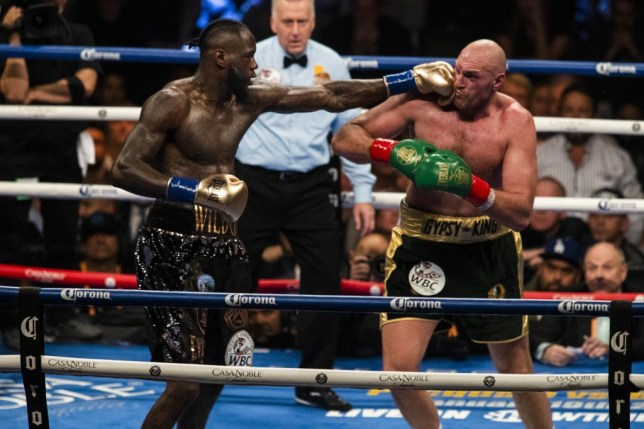 Deontay Wilder punches Tyson Fury