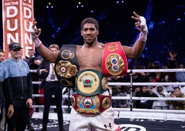 Anthony Joshua poses for a photo with the IBF, WBA, WBO & IBO World Heavyweight Title belts after the IBF, WBA, WBO & IBO World Heavyweight Title Fight between Andy Ruiz Jr and Anthony Joshua during the Matchroom Boxing 'Clash on the Dunes' show at the Diriyah Season on December 07, 2019 in Diriyah, Saudi Arabia