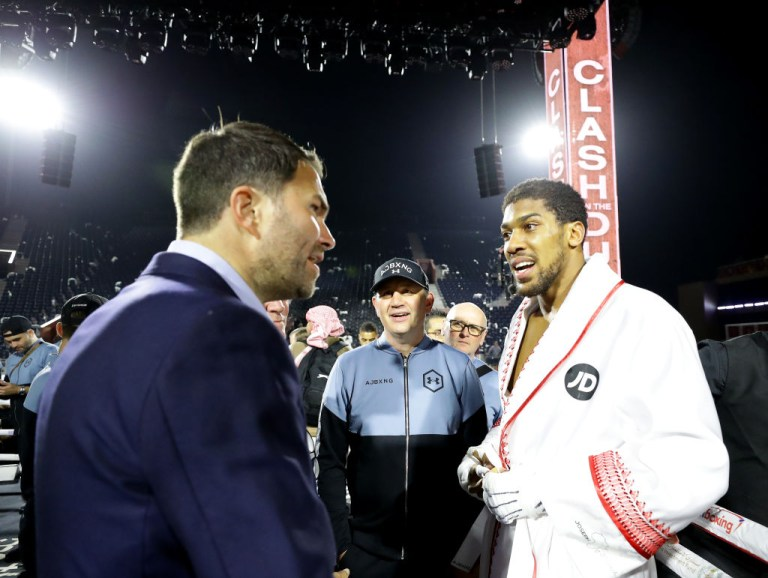 Anthony Joshua and Eddie Hearn talk after a fight