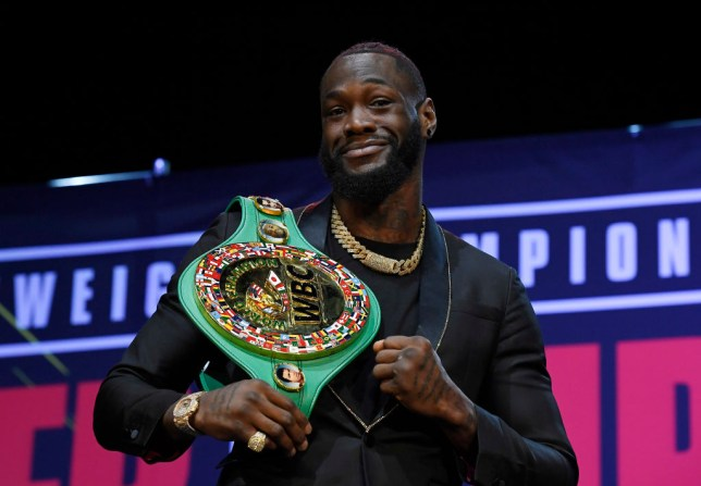 Deontay Wilder poses with his WBC title