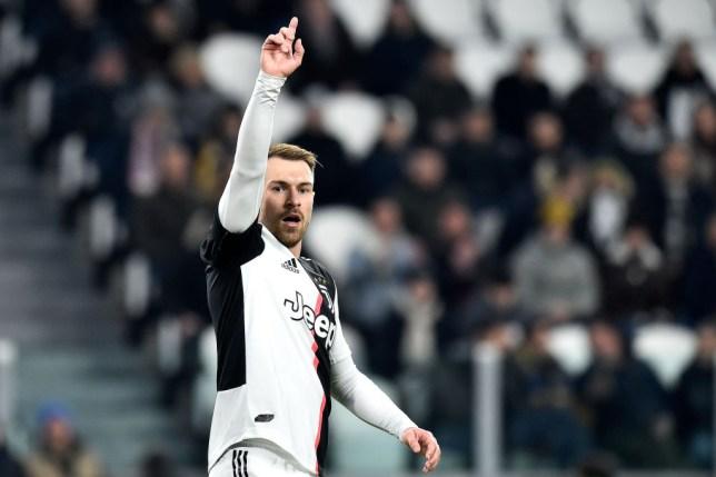 Aaron Ramsey gestures to his Juventus team-mates