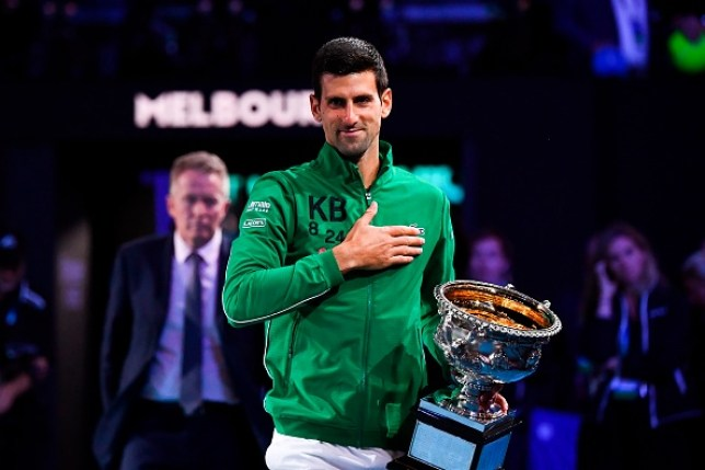 Novak Djokovic, wearing a Kobe Bryant jacket, celebrates his Australian Open win