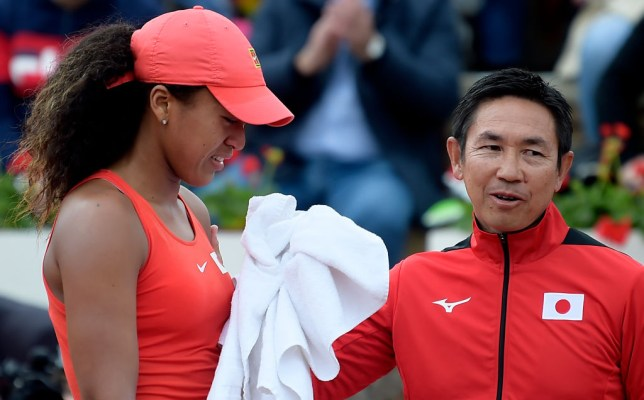 Naomi Osaka looks on in tears after her Fed Cup defeat to Sara Sorribes Tormo.