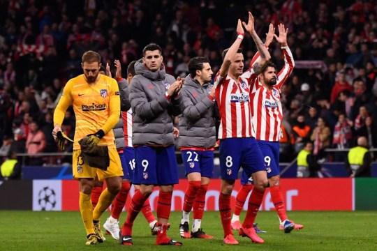 Atletico players celebrate beating Liverpool