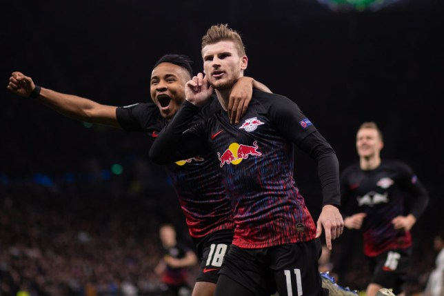 Timo Werner of RB Leipzig celebrates scoring the opening goal with Christopher Nkunku during the UEFA Champions League round of 16 first leg match between Tottenham Hotspur and RB Leipzig at Tottenham Hotspur Stadium on February 19, 2020 in London, United Kingdom.