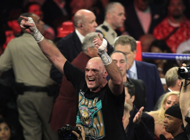 Tyson Fury celebrates his victory over Deontay Wilder