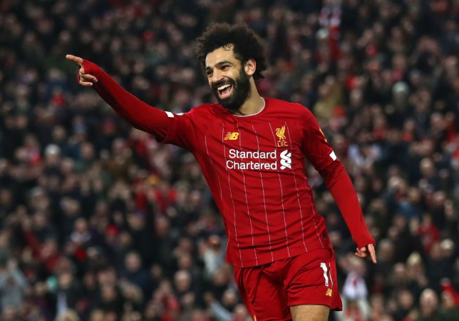 Mohamed Salah of Liverpool celebrates after scoring his team's fourth goal during the Premier League match between Liverpool FC and Southampton FC at Anfield on February 01, 2020 in Liverpool, United Kingdom.