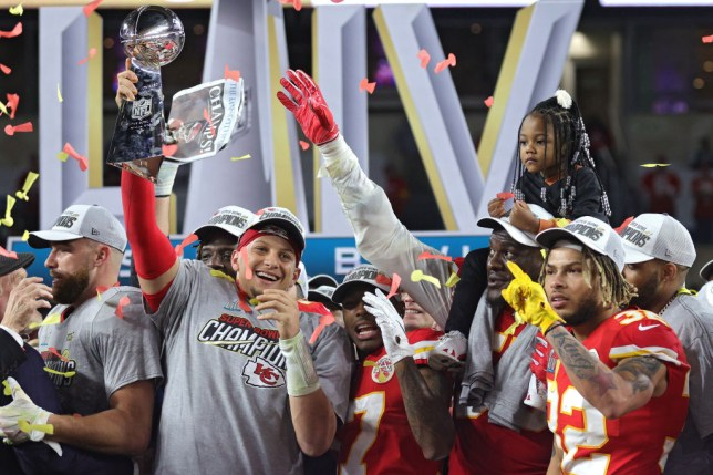 atrick Mahomes #15 of the Kansas City Chiefs raises the Vince Lombardi Trophy after winning the Super Bowl