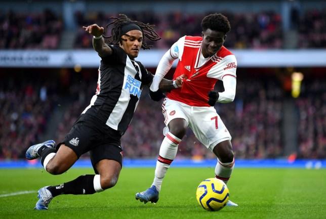 Arsenal midfielder Bukayo Saka and Newcastle defender Valentino Lazaro