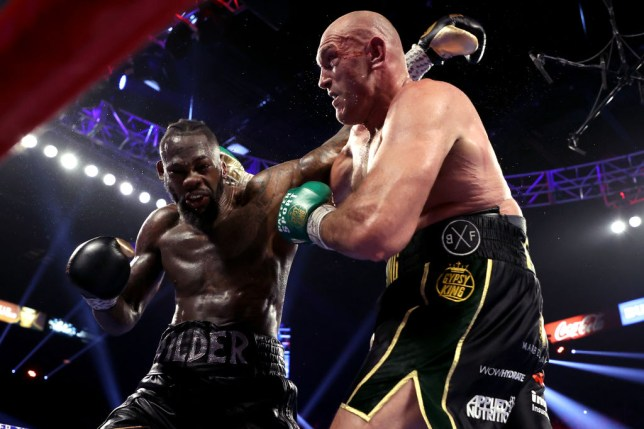 Tyson Fury (R) and Deontay Wilder exchange punches during their Heavyweight bout for Wilder's WBC and Fury's lineal heavyweight title on February 22, 2020 at MGM Grand Garden Arena in Las Vegas, Nevada.