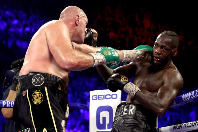 Tyson Fury (L) punches Deontay Wilder during their Heavyweight bout for Wilder's WBC and Fury's lineal heavyweight title on February 22, 2020 at MGM Grand Garden Arena in Las Vegas, Nevada.