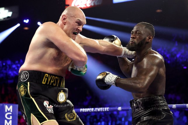Tyson Fury (L) and Deontay Wilder exchange punches during their Heavyweight bout for Wilder's WBC and Fury's lineal heavyweight title on February 22, 2020 at MGM Grand Garden Arena in Las Vegas, Nevada.