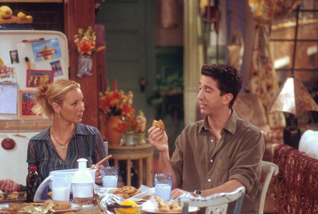 Ross and Phoebe in Friends eating at a table