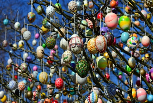 Easter eggs hang from a tree