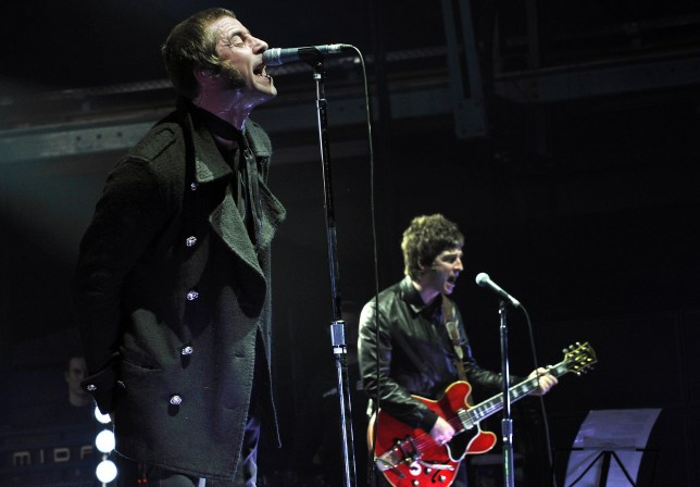 Liam and Noel Gallagher (R) of the band Oasis.