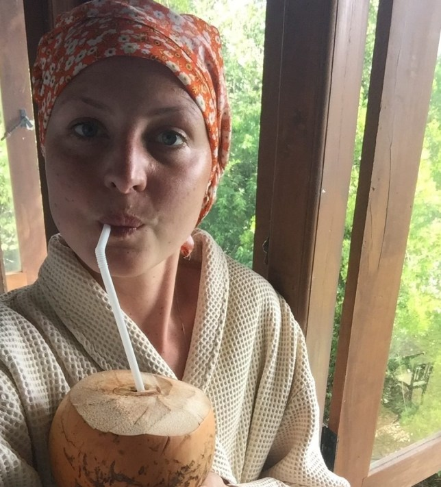 Kris Hallenga drinking coconut water at a spa