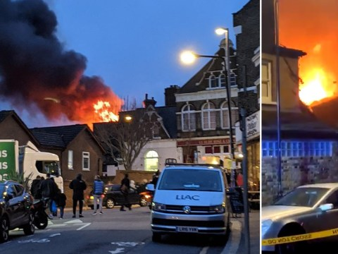 Firefighters battle huge blaze near iconic pub in east London