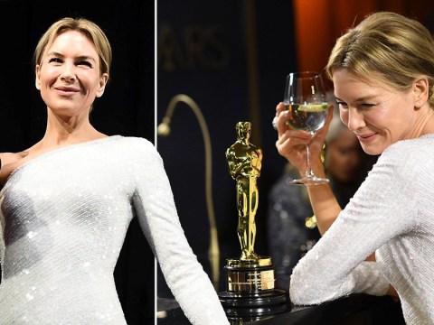 Oscar winner Renee Zellweger looks delighted as she nurses her drink while her award is engraved