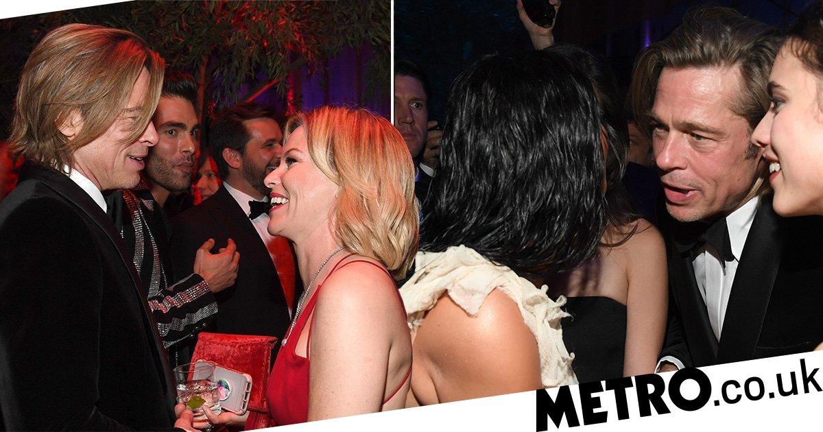 Brad Pitt charms the pants off Kim Kardashian and Elizabeth Banks at Oscars bash