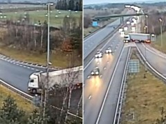 Moment lorry driver performs dangerous U-turn into oncoming traffic