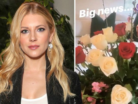 Vikings' Katheryn Winnick demands our attention as she celebrates 'big news' with huge bouquet