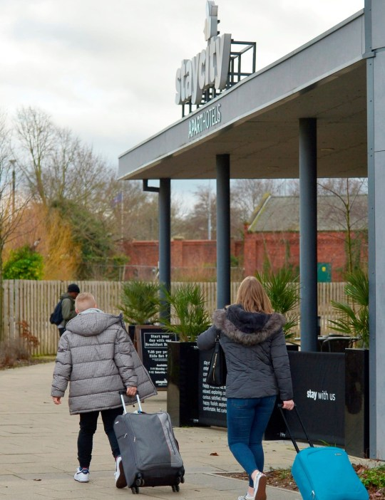 Guests arrive at Staycity Hotel in the centre of York. 31 January 2020. The hotel believed to be at the centre of the UK's first coronavirus outbreak was still open for business today (Fri) with bosses claiming health chiefs had NOT been in recent contact. See SWNS story SWLEvirus. The claim came as a huge national hunt was underway to trace anyone who had come into contact with the pair. Two Chinese nationals who tested positive for the deadly virus are thought to have stayed at the ?140-a-night Staycity Hotel in York city centre before falling ill. The rooms they stayed were sealed off and are being deep-cleaned today but the 220-bedroom hotel is still open for business. The un-named tourists called paramedics on Thursday after one of them became ill. A hotel spokesperson said Public Health England officials had not officially confirmed with them that the patients who had tested positive had stayed there. Official advice is that anyone who comes into close contact with virus carriers self-isolate or are quarantined to prevent spreading infection. It is not know whether any Staycity staff who came into contact with the tourists have been quarantined or put in self isolation.