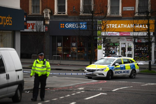 Police at the scene in Streatham High Road, south London after a man was shot by armed officers, with police declaring the incident as terrorist-related. PA Photo. Picture date: Sunday February 2, 2020. See PA story POLICE Streatham. Photo credit should read: Victoria Jones/PA Wire