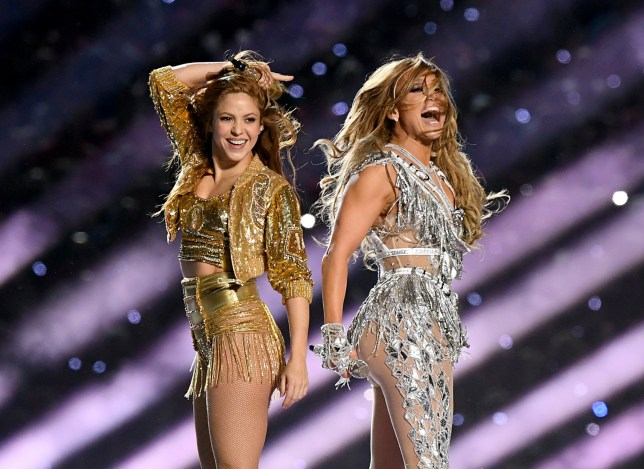 Shakira and Jennifer Lopez perform onstage during the Pepsi Super Bowl