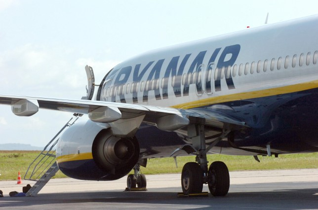 A Boeing 737, which was carrying 168 passengers and seven crew members, from Bristol to Barcelona, sits on the tarmac at Limoges airport, central France, on August 26, 2008, hours after a night emergency landing. The jet from the low-cost Irish air company Ryanair plunged 8,000 metres (26,400 feet) after a sudden loss of cabin pressure over France. Sixteen people were taken to hospital for ear problems. AFP PHOTO PASCAL LACHENAUD (Photo credit should read PASCAL LACHENAUD/AFP via Getty Images)