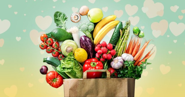 A bag of fresh fruit and vegetables with a lovey-dovey background