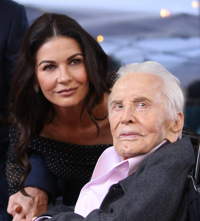 HOLLYWOOD, CALIFORNIA - NOVEMBER 06: Catherine Zeta-Jones and Kirk Douglas attend the ceremony honoring Michael Douglas with a Star on The Hollywood Walk of Fame held on November 06, 2018 in Hollywood, California. (Photo by Michael Tran/FilmMagic,)