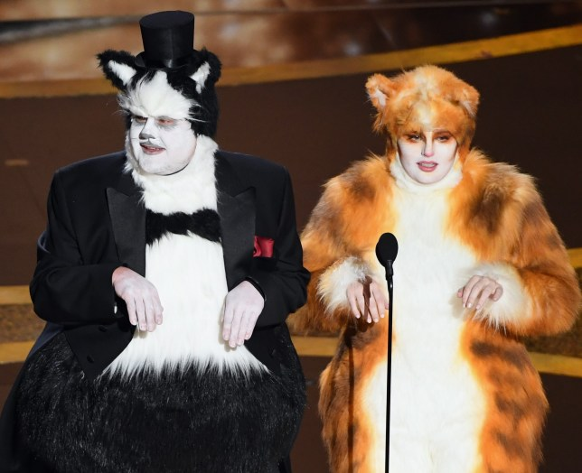 HOLLYWOOD, CALIFORNIA - FEBRUARY 09: (L-R) James Corden and Rebel Wilson speak onstage during the 92nd Annual Academy Awards at Dolby Theatre on February 09, 2020 in Hollywood, California. (Photo by Kevin Winter/Getty Images)