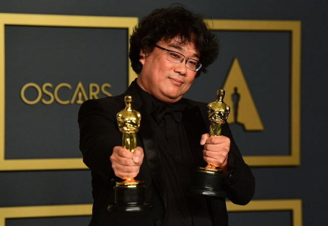 "South Korean director Bong Joon-ho poses in the press room with the Oscars for ""Parasite"" during the 92nd Oscars at the Dolby Theater in Hollywood, California on February 9, 2020. - Bong Joon-ho won for Best Director, Best Movie, Best International Feature Film and Best Original Screenplay for ""Parasite"". (Photo by FREDERIC J. BROWN / AFP) (Photo by FREDERIC J. BROWN/AFP via Getty Images)"