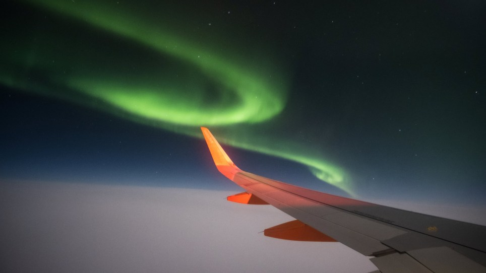 "Green aurora seen from the window of an Easyjet flight from Iceland to the UK by Ross Martin on 6/02/20. See SWNS copy SWCAaurora: A British man has captured a series of mesmerizing photos of the Northern Lights from his plane window as he flew home from Iceland. Photographer Ross Martin, 38, said the whole plane was ""in awe"" of the colourful lights which ""danced around the plane"" during his flight home on Thursday (February 6). The captain even circled around so that every single passenger in the plane could catch a glimpse of the stunning lights."