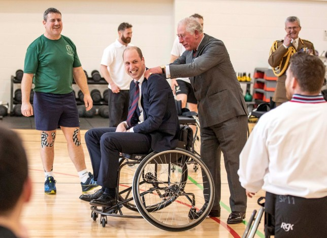 The Duke of Cambridge has his shoulders rubbed by the Prince of Wales after he attempted and failed to throw a basket ball into the hoop while playing wheelchair basket ball during a visit to the Defence Medical Rehabilitation Centre Stanford Hall, Stanford on Soar, Loughborough, where they met with patients and staff and had a tour of the gym and prosthetics workshop. PA Photo. Picture date: Tuesday February 11, 2020. See PA story ROYAL Charles. Photo credit should read: Richard Pohle/The Times/PA Wire