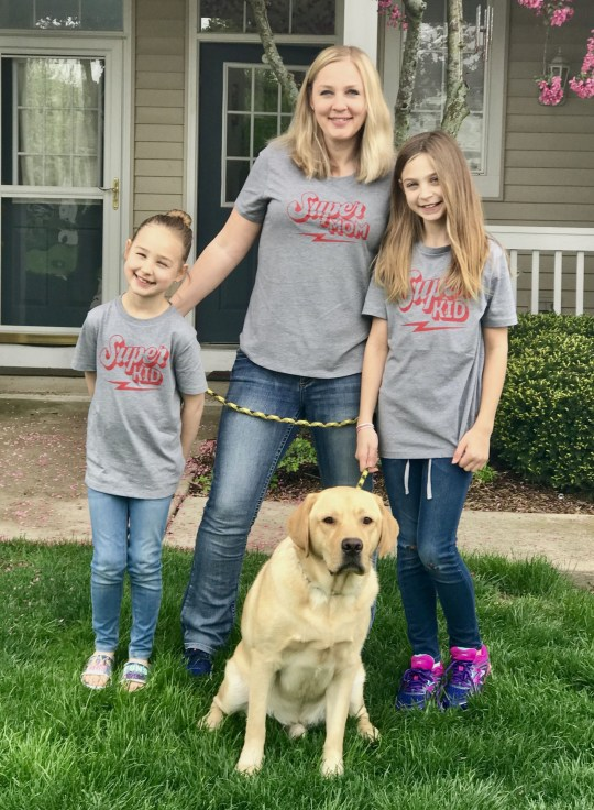 PIC FROM Jacquelyn Hensley / Kennedy News (PICTURED: MILLER WITH HIS OWNER JACKIE HENSLEY, 39, AND HER TWO DAUGHTERS QUINN, NINE, AND TAYLOR, 12, LEFT TO RIGHT.) Hilarious photos show an obese labrador looking miserable after losing almost a quarter of his bodyweight - though his owner swears he actually couldn't be happier. Despite tipping the scales at a whopping 107lbs (48kg) - almost 30lbs (13kg) heavier than a healthy weight for his breed - canine Miller always appeared to crack a smile for the camera. The pooch's weight had shot up due to overfeeding and sneaking human snacks - with a particular penchant for peanut butter. DISCLAIMER: While Kennedy News and Media uses its best endeavours to establish the copyright and authenticity of all pictures supplied, it accepts no liability for any damage, loss or legal action caused by the use of images supplied and the publication of images is solely at your discretion. SEE KENNEDY NEWS COPY - 0161 697 4266
