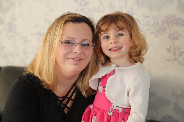 BNPS.co.uk (01202 558833) Pic: CorinMesser/BNPS Sophia(2) with her mum Samantha.??A two-year-old girl saved her mother by managing to unlock her phone and raise the alarm after she fell unconscious at home.??Little Sophia Mizen sprung into action when mum Debbie collapsed in her kitchen in Poole, Dorset.??She got hold of her mum's Huawei phone, unlocked it using the finger sensor and then opened Facebook messenger before clicking on her grandmother's face to video call her.?