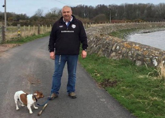 Dated: 13/02/2020 Dog owner Martin Fletcher, from Redcar, who lost his tooth after biting a Rottweiler while it was savagely attacking his pet Jack Russells, Ben and Jerry, leaving one needing over 30 stitches. Pictured with Ben. See story North News