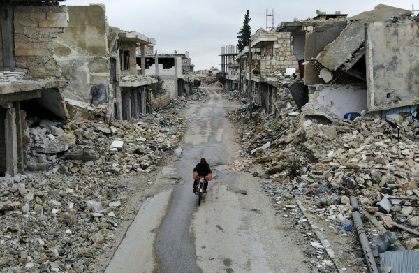 An aerial picture taken on February 15, 2020, shows a Syrian man on a motorbike in the deserted Syrian city of Kafranbel, south of Idlib city in the eponymous northwestern province, amid an ongoing pro-regime offensive. (Photo by Omar HAJ KADOUR / AFP) (Photo by OMAR HAJ KADOUR/AFP via Getty Images)