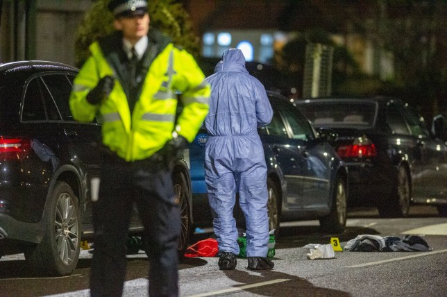 ?? Licensed to London News Pictures. 16/02/2020. London, UK. A forensic investigator gathers evidence next to medical equipment on the ground at the scene of a multiple stabbing in Barking. Photo credit: Peter Manning/LNP