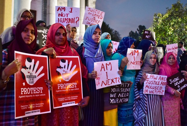 Activists from various women's rights organisations hold placards as they protest against sexual harassment, rapes and murders of women across the country urging the government to help uphold the women's rights, during a demonstration in Bangalore on December 11, 2019. (Photo by STR / AFP) (Photo by STR/AFP via Getty Images)