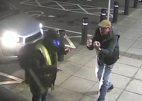 """Video grab of the astounding moment a 77-year-old fought back against a would-be mugger outside a Sainsburys store in Cardiff, Wales - and can be seen shouting, """"Come on, then"""". See SWNS story SWBRpunch. This is the astonishing moment a mugger at a cash machine met his match - a 77-YEAR-OLD who put his fists up for a fight. The CCTV footage shows the pensioner parking in a seemingly empty Sainsbury's car park on February 5, and getting out the car to withdraw some cash. As the elderly victim walks away from the cash point, he is intercepted by the attempted mugger, wearing a high-vis vest jacket, who grabs him and shoves him against a bin. But in a surprising turn, the pensioner fought back - shoving the man away, before quickly throwing up his fists in a fight stance, and even throwing some punches at the man's neck and gut."""