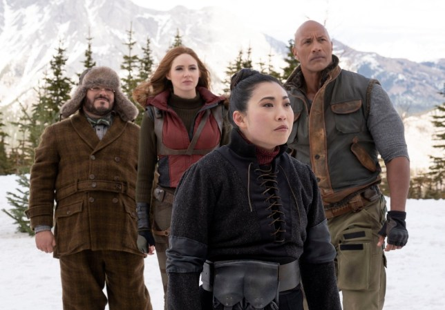 Editorial use only. No book cover usage. Mandatory Credit: Photo by Frank Masi/Columbia/Sony/Kobal/REX/Shutterstock (10506502h) Jack Black as Bethany/Fridge, Karen Gillan as Ruby Roundhouse, Awkwafina as Ming and Dwayne Johnson as Eddie 'Jumanji: The Next Level' Film - 2019 In Jumanji: The Next Level, the gang is back but the game has changed. As they return to rescue one of their own, the players will have to brave parts unknown from arid deserts to snowy mountains, to escape the world's most dangerous game.