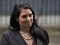 FILE - In this file dated Thursday, Feb. 13, 2020, British Lawmaker Priti Patel, the Home Secretary leaves 10 Downing Street in London. Britain has announced Wednesday Feb. 19, 2020, new post-Brexit ???points-based immigration system??? said Patel, that will assess prospective immigrants on a range of skills, qualifications, salaries or professions, starting next year. (AP Photo/Matt Dunham, FILE)