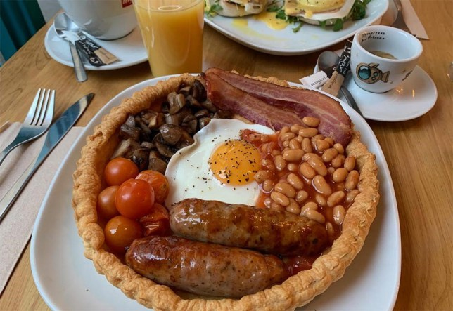 Bacon, eggs, baked beans (no longer in danger of spilling off the plate), tomato, sausage and mushrooms (with optional hash browns and black pudding) all served up in a huge puff pastry base.