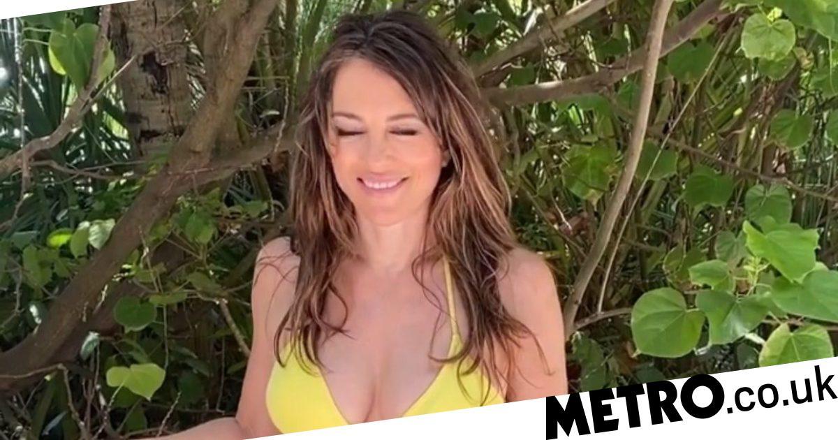 Elizabeth Hurley goes for a bike ride in her bikini in the Maldives