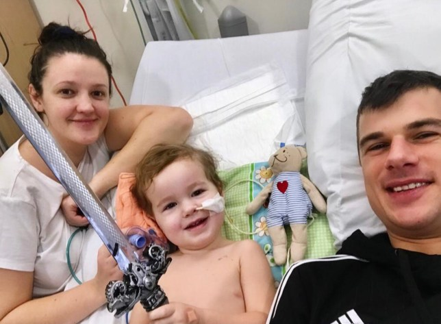 Alex who has cancer with mum Kamila and dad Pawel in hospital